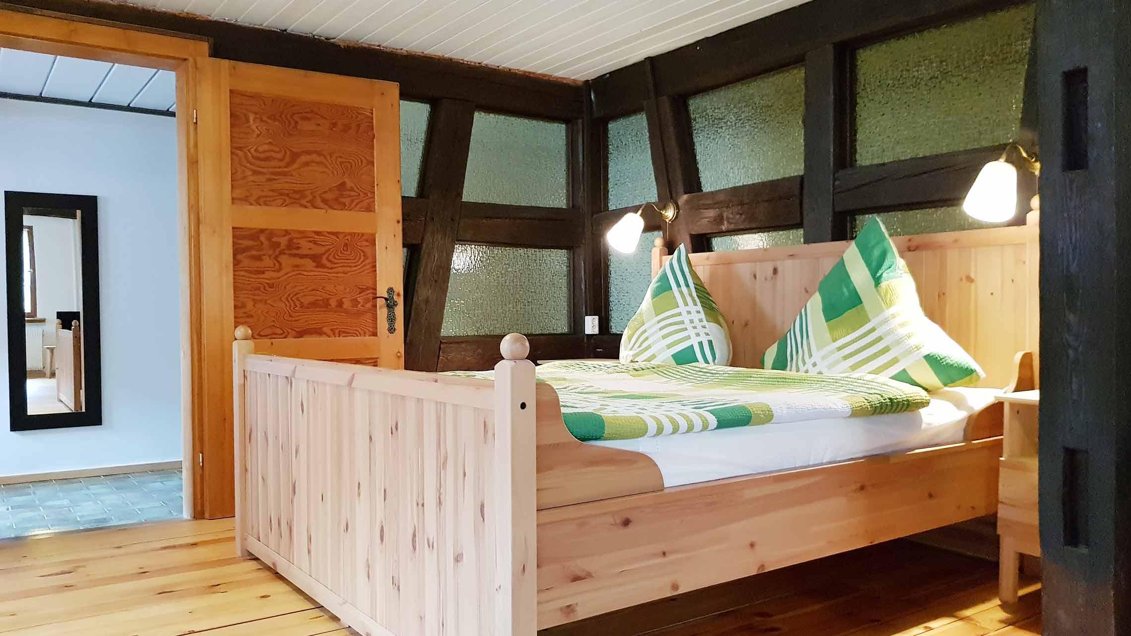 oelehof-akademie-ferienwohnung-laendliches-loft-schlafbereich-c