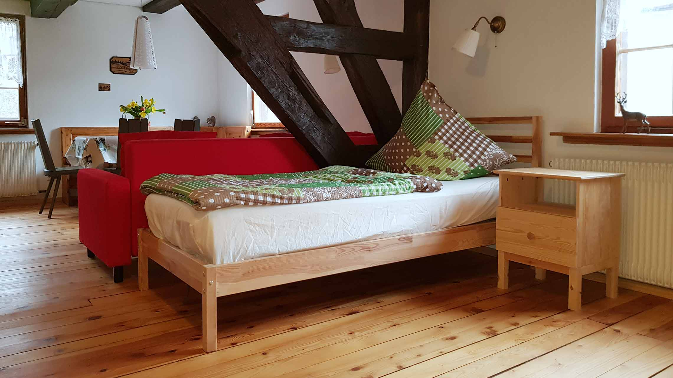 oelehof-akademie-ferienwohnung-laendliches-loft-schlafbereich2-d
